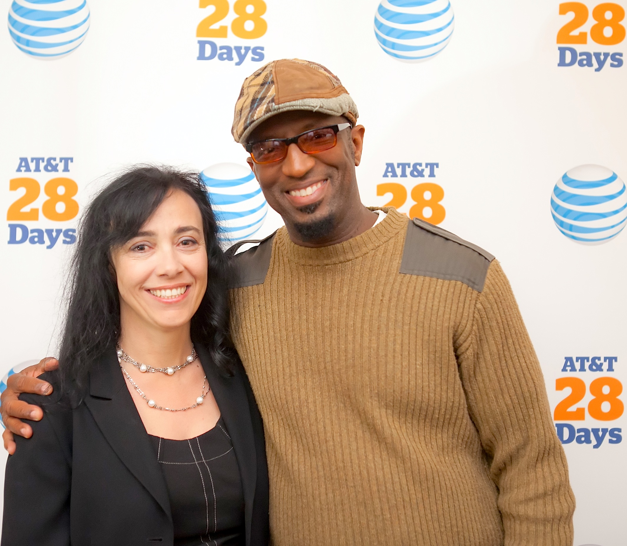 Rosa Esquivel, Director Diverse Markets at AT&T Mobility and 28 Days host, Rickey Smiley, share a moment during the Speaker Series held at the Carolina Theatre in Durham, NC.